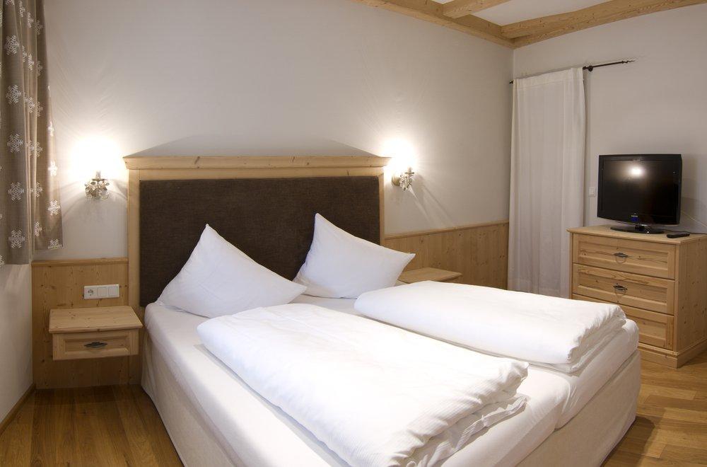 Schlafzimmer mit Boxspringbett Apartment Gänseblümchen