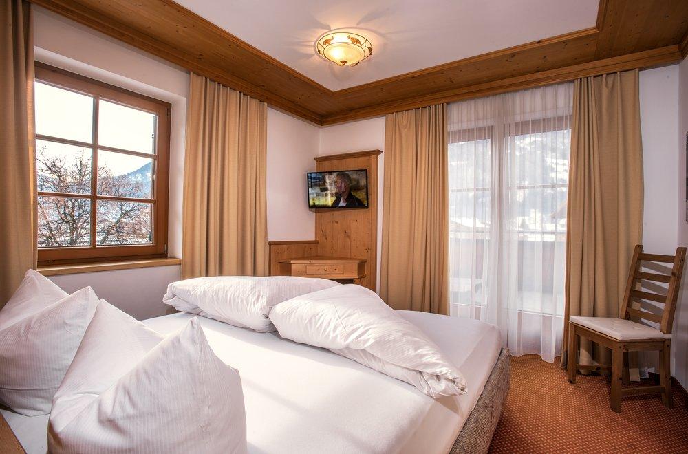 Schlafzimmer mit Balkon Apartment Hochzillertal